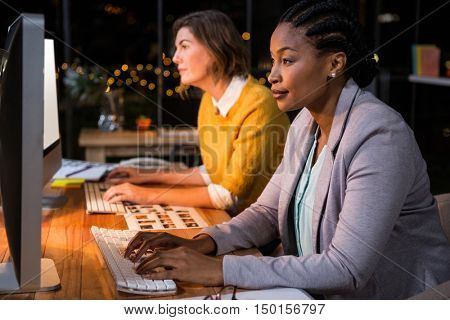 Businesswomen working on computer at their desk in the office