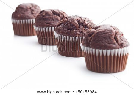 The tasty chocolate muffin isolated on white background. Focus on second muffin.