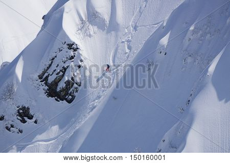 Snowboard freeride, snowboarders and tracks on a mountain slope. Extreme sport.