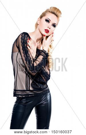 Sexy young woman with fashion bright makeup and manicure posing at studio isolated on white.