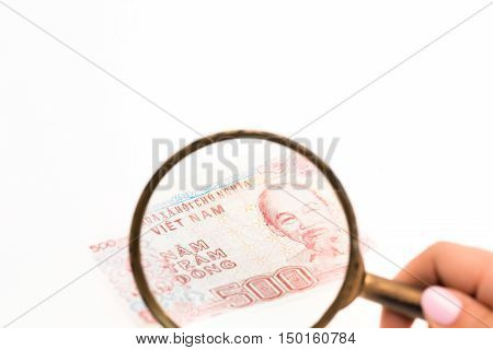 New 500 dongs -Vietnamese banknote under a magnifying glass