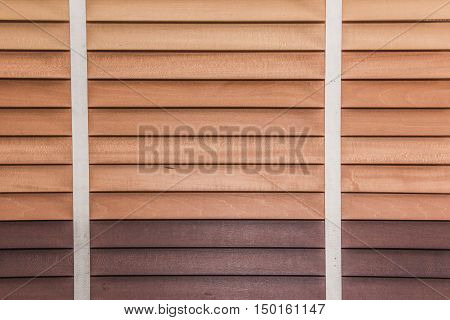 Close up of wooden jalousie window. Brown