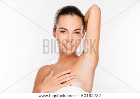 Beauty portrait of a smiling woman looking at camera isolated on a white background