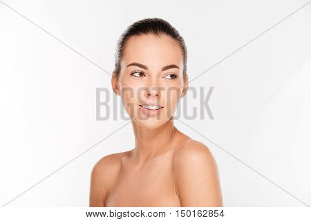 Beauty portrait of a beautiful woman with fresh skin looking away isolated on a white background