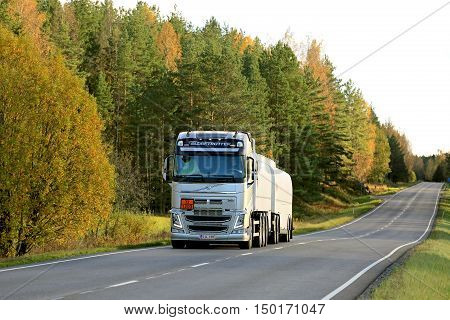 SALO, FINLAND - OCTOBER 2, 2016: Volvo FH fuel tank truck on rural road in autumn landscape.