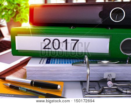 2017 - Green Ring Binder on Office Desktop with Office Supplies and Modern Laptop. 2017 Business Concept on Blurred Background. 2017 - Toned Illustration. 3D Render.