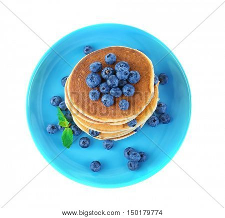 Tasty pancakes with blueberries on plate, isolated on white