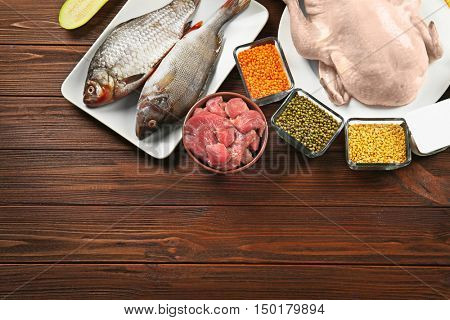 Food high in protein on wooden background
