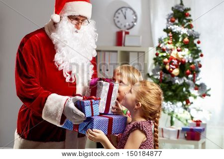 Santa Claus carrying Christmas presents for children