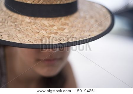 Latin sad woman wearing a straw hut