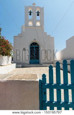 Traditional orthodox white small church with belfry in the Greek island of Sifnos in Greece