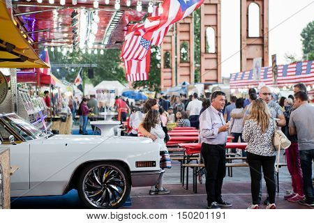 TURIN ITALY -JULY 01 2016: people an view of the Street Food parade in Parco Dora park Turin Italy