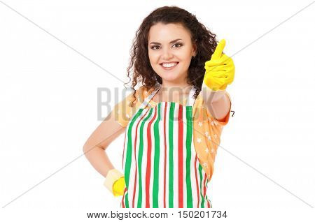 Beautiful young housewife with yellow latex cleaning gloves. Young happy woman put on hand yellow rubber glove, looking at camera and doing a thumb up gesture, isolated on white background.