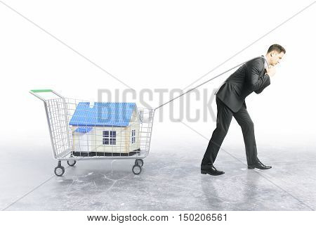 Businessman dragging trolley with blue house on white background. Property shopping concept. 3D Rendering