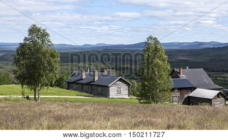 HARJEDALEN, SWEDEN ON JULY 07. View of the countryside and lifestyle up North on July 07, 2016 in Harjedalen, Sweden. Horizon and wooden log buildings on a slope. Editorial use.