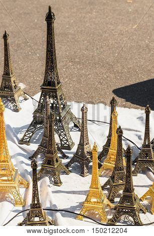 Trade in souvenirs outside. Sheet with souvenirs in the form of the Eiffel Tower a traditional gift from Paris on Montmartre hill.