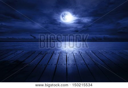 wood terrace for night relax by see the nice full moon