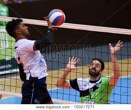 KAPOSVAR, HUNGARY - SEPTEMBER 30: Arrun Nesarajah (with ball) in action at a Hungarian National Championship volleyball game Kaposvar (green) vs. PEAC (white), September 30, 2016 in Kaposvar, Hungary.