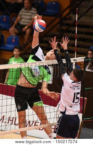 KAPOSVAR, HUNGARY - SEPTEMBER 30: Bence Bozoki (with ball) in action at a Hungarian National Championship volleyball game Kaposvar (green) vs. PEAC (white), September 30, 2016 in Kaposvar, Hungary.