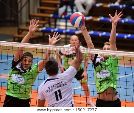 KAPOSVAR, HUNGARY - SEPTEMBER 30: Bence Bozoki (green 2) in action at a Hungarian National Championship volleyball game Kaposvar (green) vs. PEAC (white), September 30, 2016 in Kaposvar, Hungary.