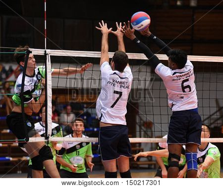 KAPOSVAR, HUNGARY - SEPTEMBER 30: Akos Kalmar (in left) in action at a Hungarian National Championship volleyball game Kaposvar (green) vs. PEAC (white), September 30, 2016 in Kaposvar, Hungary.
