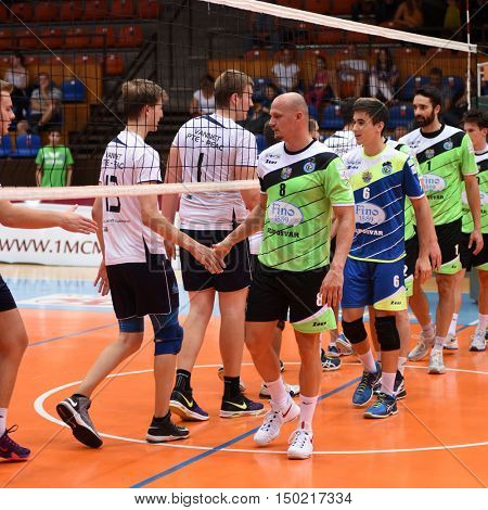 KAPOSVAR, HUNGARY - SEPTEMBER 30: Competitors shake hands before a Hungarian National Championship volleyball game Kaposvar (green) vs. PEAC (white), September 30, 2016 in Kaposvar, Hungary.