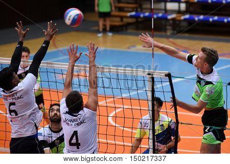 KAPOSVAR, HUNGARY - SEPTEMBER 30: Bence Bozoki (in right) in action at a Hungarian National Championship volleyball game Kaposvar (green) vs. PEAC (white), September 30, 2016 in Kaposvar, Hungary.