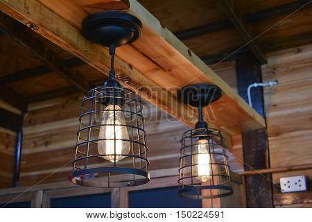 Wooden houses decorated with vintage tungsten lamp.