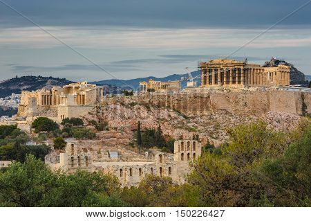Ancient Acropolis in rays of sunset. Athens Greece. Copyspace.