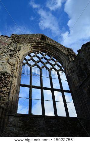 Stone window ruins of Holyrood Abbey in Edinburgh Scotland.