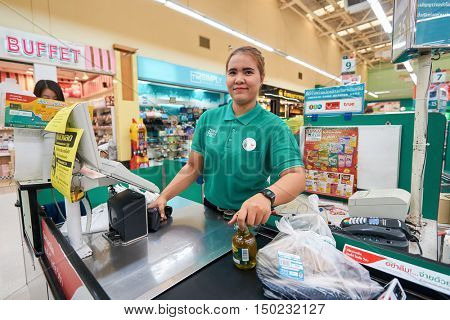 PATTAYA, THAILAND - FEBRUARY 22, 2016: indoor portrait of a woman at the Tesco Lotus hypermarke. Tesco Lotus is a hypermarket chain in Thailand operated by Ek-Chai Distribution System Co., Ltd.