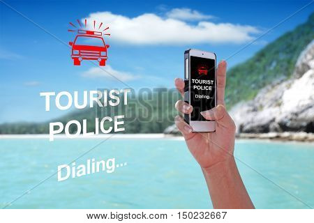 TOURIST POLICE Dialing showing on the smartphone with tropical island background.