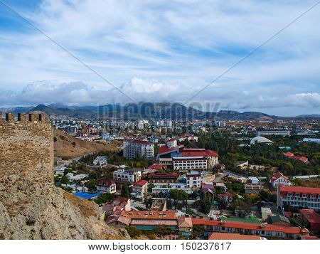 View from the ramparts of the ancient to the modern buildings of the town of Sudak in Crimea