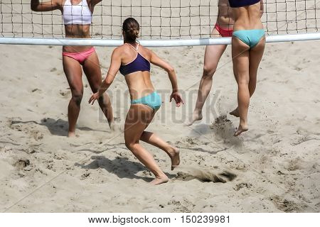Young girls playing Beach Volleyball in sunny day