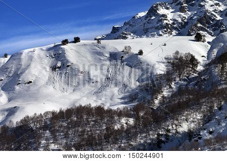 Off-piste Slope With Track From Avalanche On Sun Day