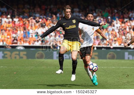 VALENCIA, SPAIN - OCTUBER 2nd: (L) Torres and Enzo Perez during Spanish soccer league match between Valencia CF and Atletico de Madrid at Mestalla Stadium on Octuber 2, 2016 in Valencia, Spain
