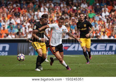 VALENCIA, SPAIN - OCTUBER 2nd: (L) Filipe Luis, 19 Rodrigo during Spanish soccer league match between Valencia CF and Atletico de Madrid at Mestalla Stadium on Octuber 2, 2016 in Valencia, Spain