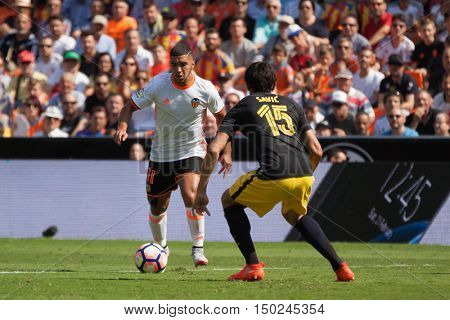 VALENCIA, SPAIN - OCTUBER 2nd: 11 Bakkali and Savic during Spanish soccer league match between Valencia CF and Atletico de Madrid at Mestalla Stadium on Octuber 2, 2016 in Valencia, Spain