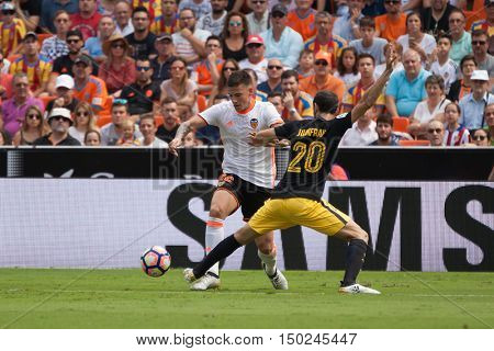VALENCIA, SPAIN - OCTUBER 2nd: (L) Santo Mina, 20 JuanFran during Spanish soccer league match between Valencia CF and Atletico de Madrid at Mestalla Stadium on Octuber 2, 2016 in Valencia, Spain