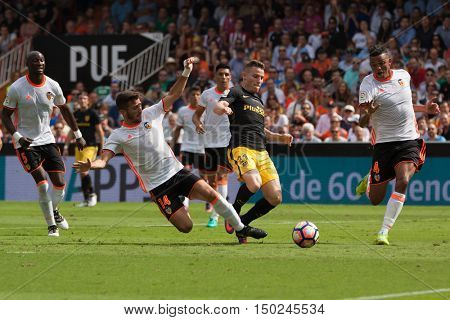 VALENCIA, SPAIN - OCTUBER 2nd: 14 Gaya, 21 Gameiro, 4 Santos during Spanish soccer league match between Valencia CF and Atletico de Madrid at Mestalla Stadium on Octuber 2, 2016 in Valencia, Spain