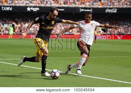VALENCIA, SPAIN - OCTUBER 2nd: (L) JuanFran (R) Nani during Spanish soccer league match between Valencia CF and Atletico de Madrid at Mestalla Stadium on Octuber 2, 2016 in Valencia, Spain
