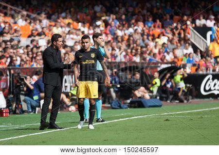 VALENCIA, SPAIN - OCTUBER 2nd: (L) Cholo Simeone (C) Correa during Spanish soccer league match between Valencia CF and Atletico de Madrid at Mestalla Stadium on Octuber 2, 2016 in Valencia, Spain