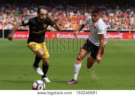 VALENCIA, SPAIN - OCTUBER 2nd: (L) JuanFran (R) Cancelo during Spanish soccer league match between Valencia CF and Atletico de Madrid at Mestalla Stadium on Octuber 2, 2016 in Valencia, Spain
