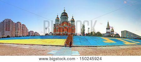 KYIV, UKRAINE - MAY 2,3 2016: Flags of Ukraine (left) and Crimean Tatars (right) on Obolon embankment, Kyiv, Ukraine, in the evening