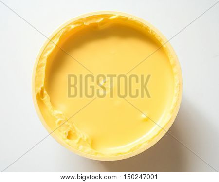 Top view of bowl with creamy margarine.