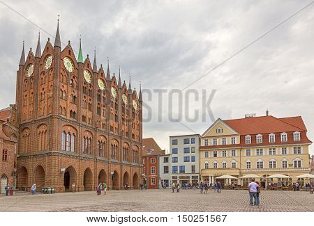 Stralsund, Germany - September 23, 2016: Alter Markt, the central square of Stralsund with the gothic town hall.