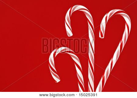 Candy canes with red background.  Macro image with copy space included.