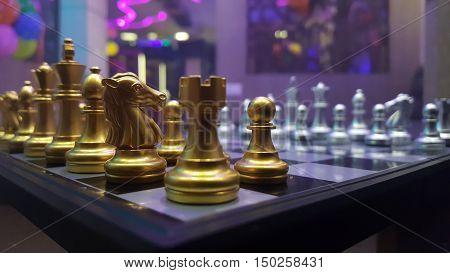 Close up for chess bord pieces in golden colour