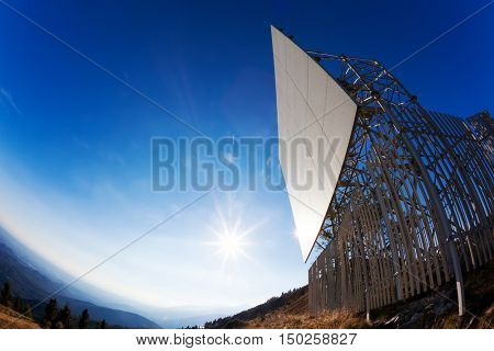 Telecommunication tower on a bright blue sunny sky