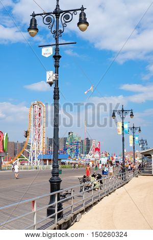 NEW YORK,USA - AUGUST 18,2016 : The colorful seaside boardwalk at Coney Island in New York City